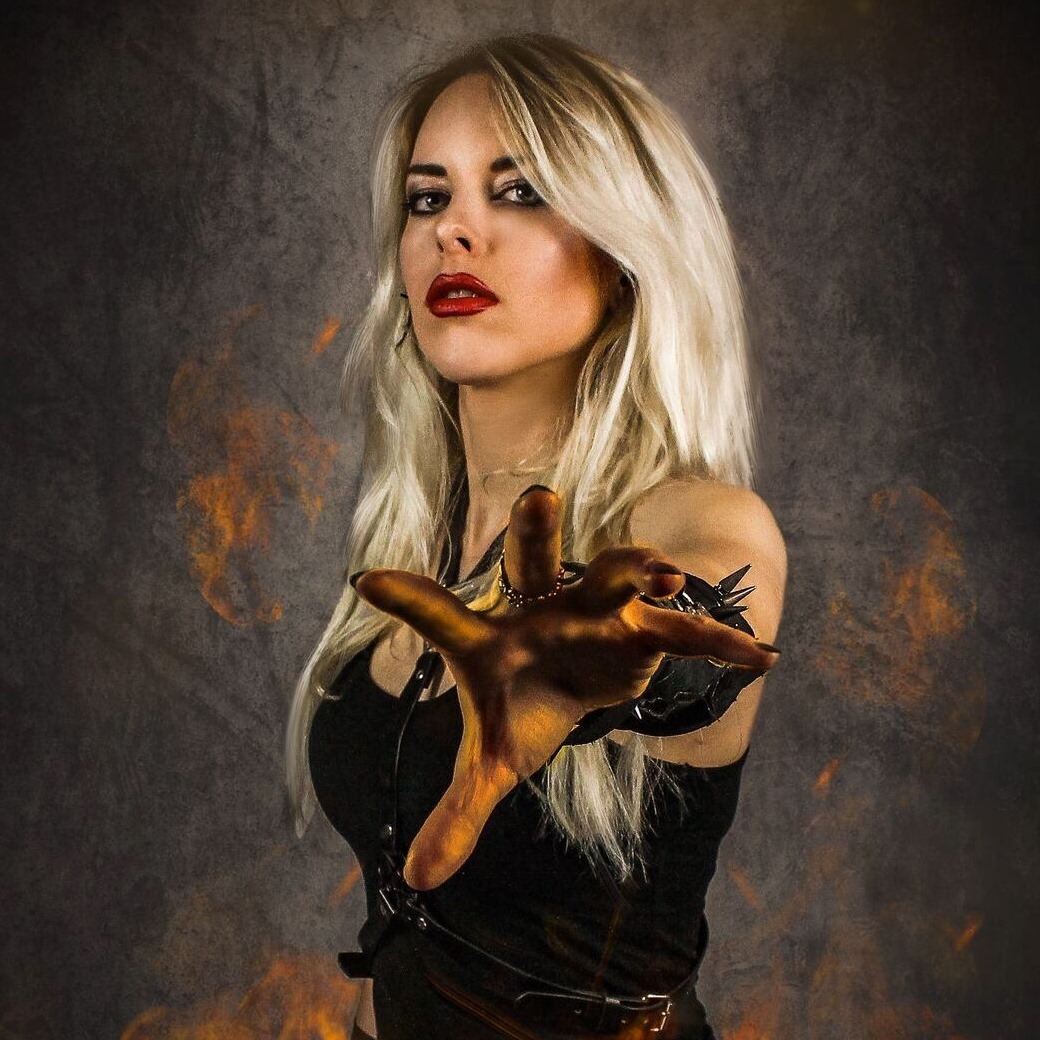 BURNING WITCHES - Laura